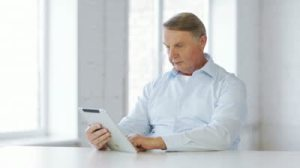 stock-footage-business-office-oldness-school-and-education-concept-old-man-with-tablet-computer-at-home